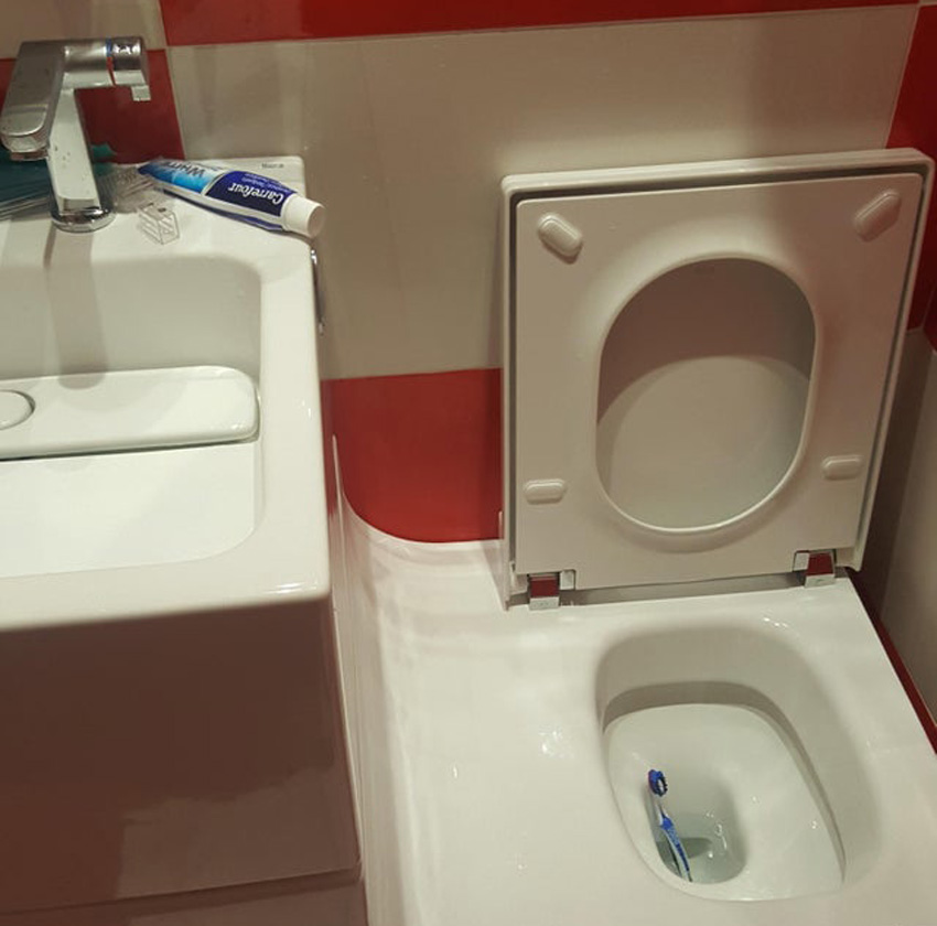sliding ramp attached to a sink that connects to a toilet