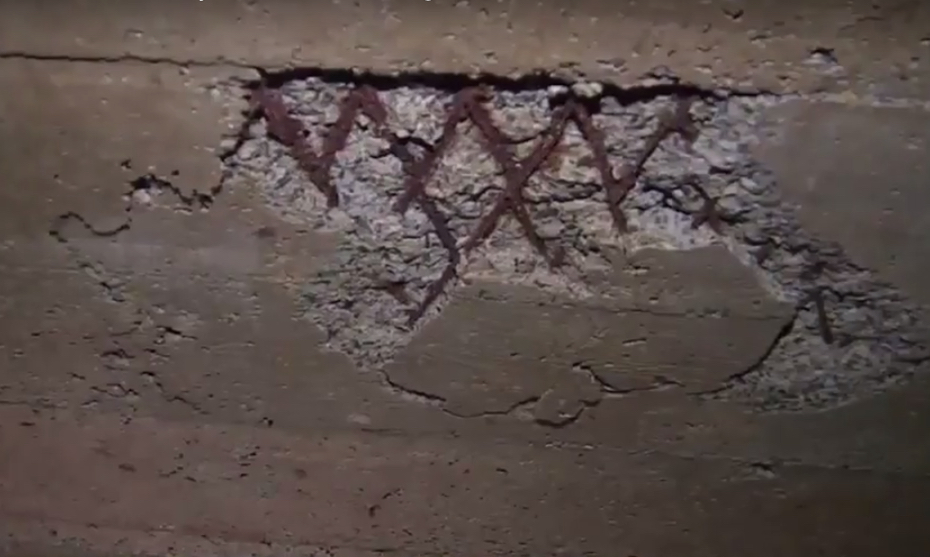 wall in hidden room with markings on it