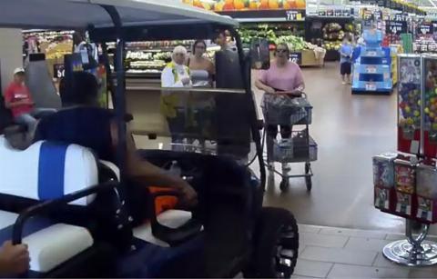 Man driving golf cart through Walmart