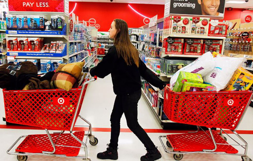 Girl with two shopping carts