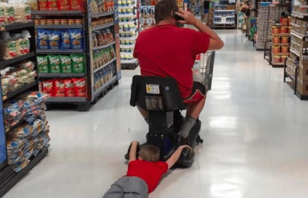 Boy dragging behind cart