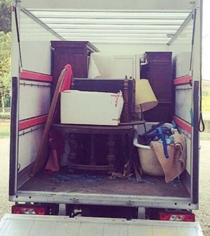 Erin and JB's moving truck filled with antique furniture