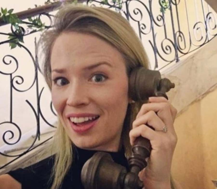 Erin answering the phone in a silly way in the Chateau de Bourneau