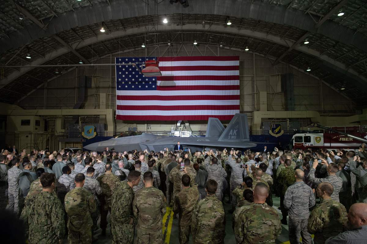 US President Donald Trump speaks to US troops at Joint Base in 2019