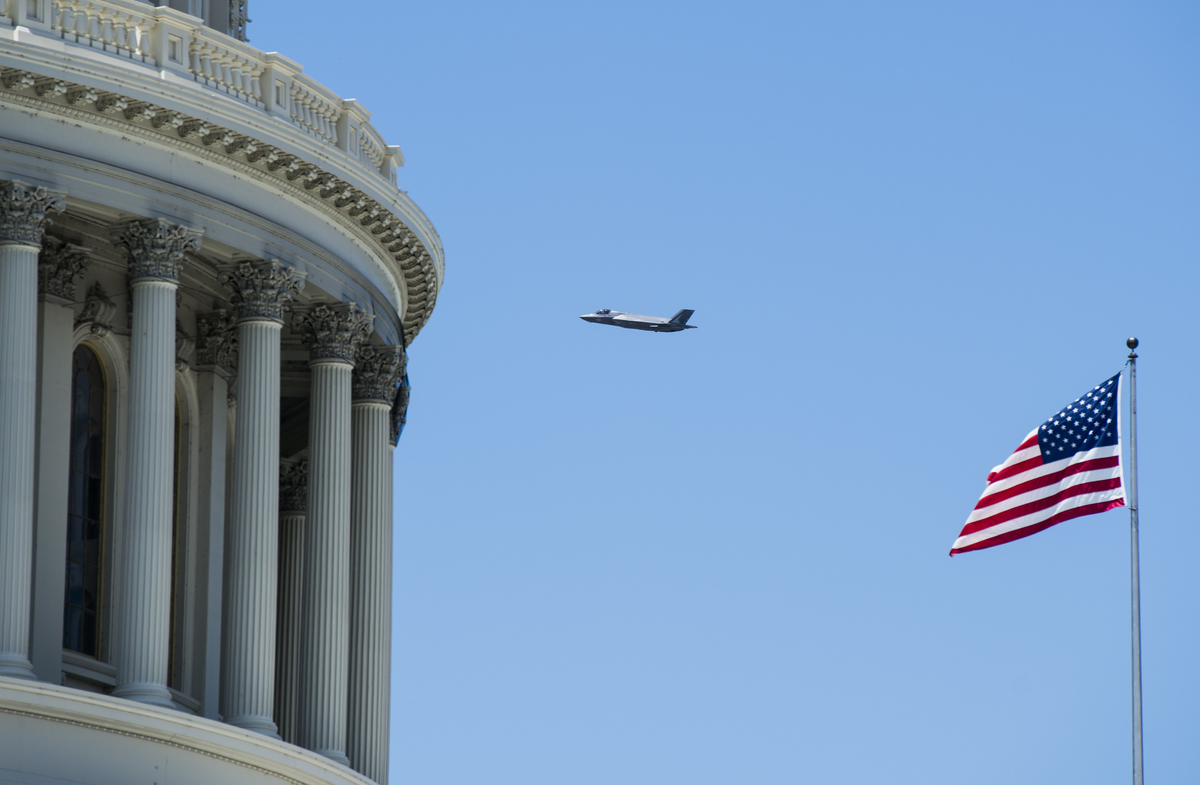 An F-35 flies past the U.S. Capitol dome during a flyover in Washington, 2019