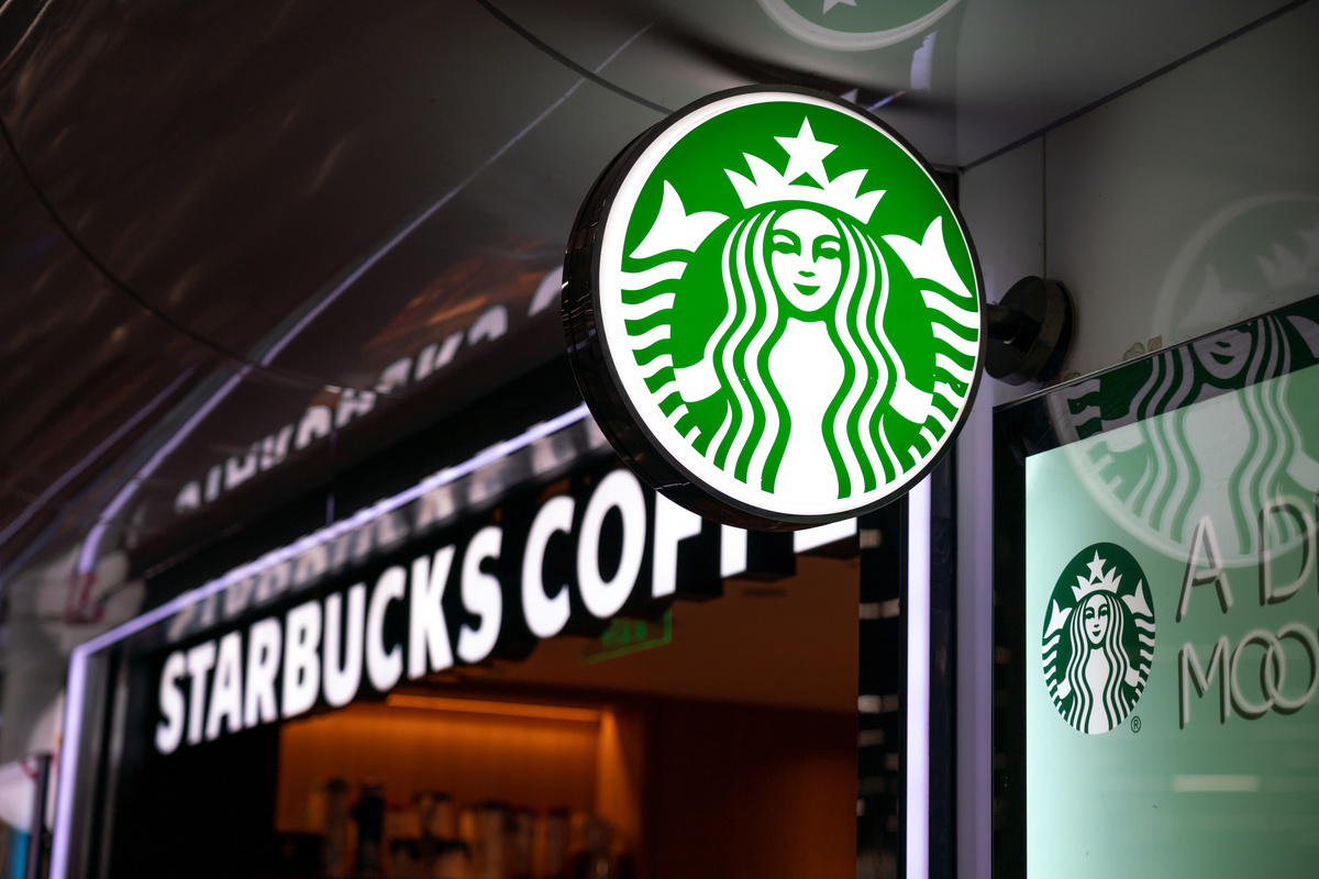 An American coffee company and coffeehouse chain Starbucks store and logo seen at the People's Square Station in Shanghai.