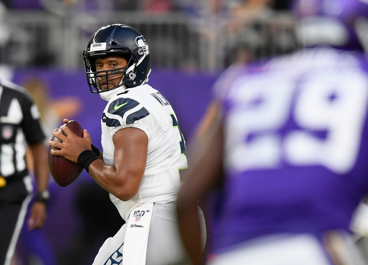 Russell Wilson #3 of the Seattle Seahawks looks to pass the ball against the Minnesota Vikings , 2019