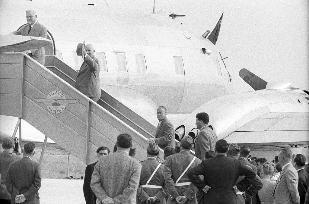 Circa 1955, the Soviet Prime Minister boards an aircraft.