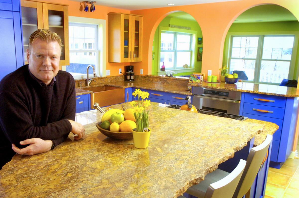 John Yates in the kitchen of his new home in Old Orchard Beach