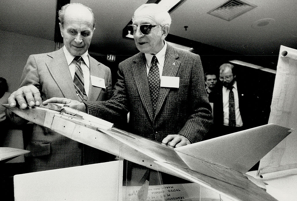 Canadian test pilots examine a small Avro Arrow model from which a prototype would be based.