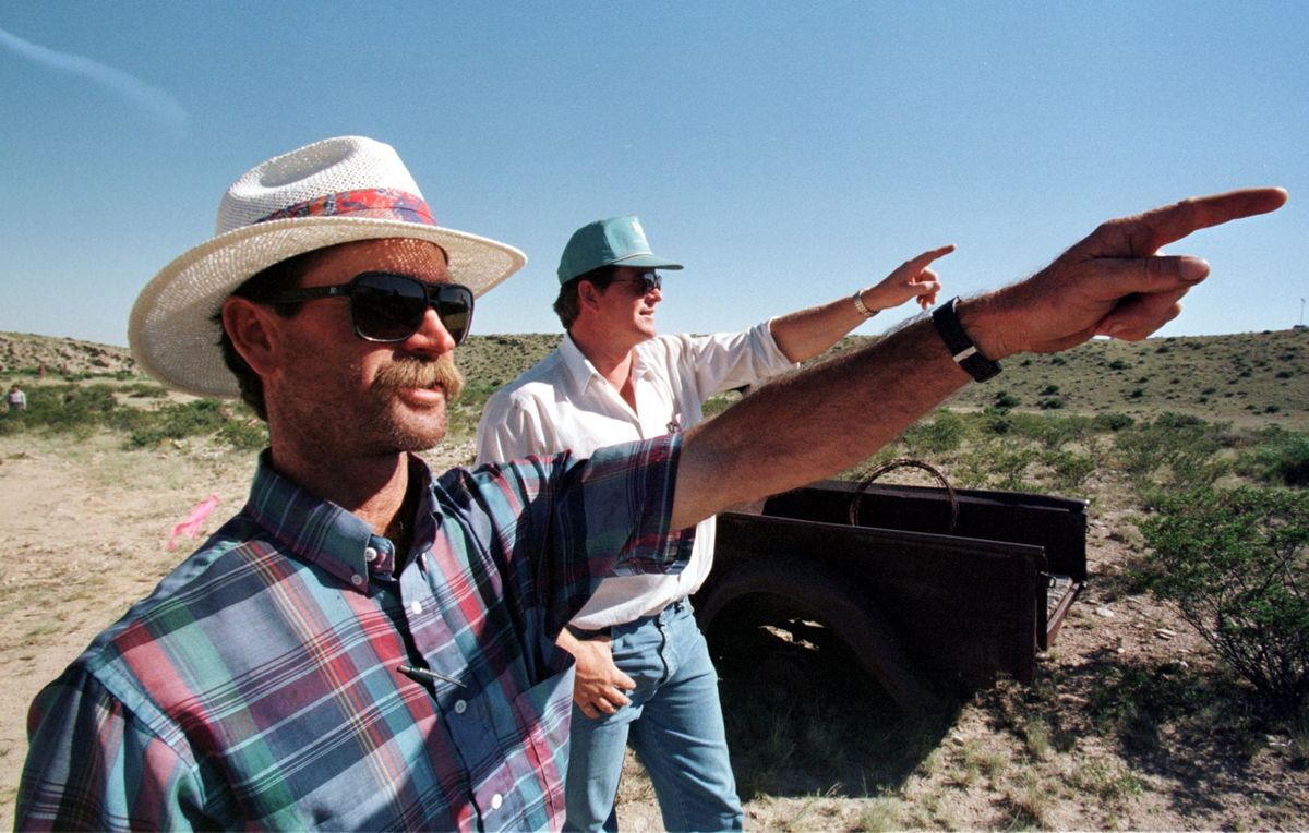 David Corn (L) and his cousin Bill Marley point toward the direction from where the alleged UFO came, before crashing at his ranch 50 years ago in Roswell, New Mexico.