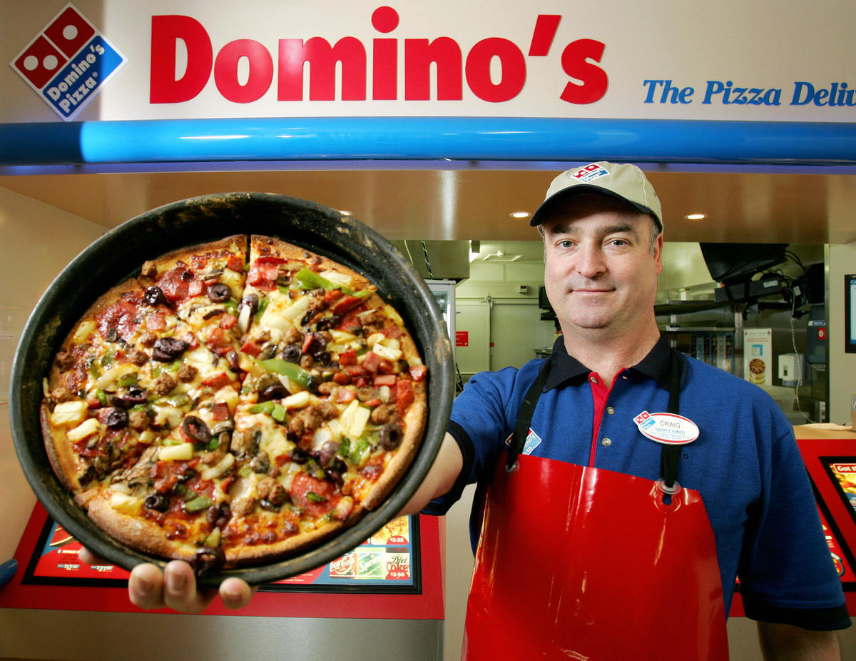 Craig Birchall, a Domino's Pizza franchisee, displays his super supreme pizza