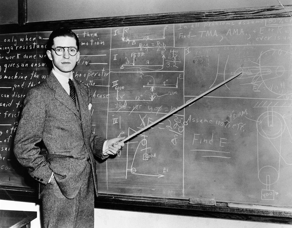 man at the chalkboard