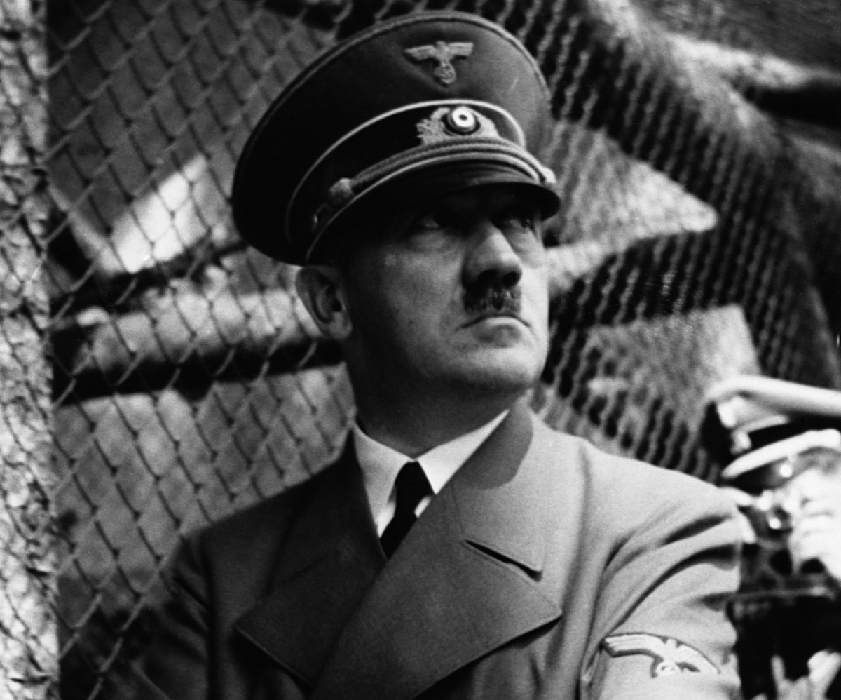 Nazi dictator Adolph Hitler in front of zoo cage.
