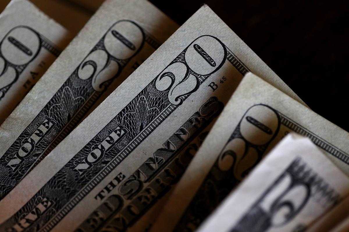 Twenty and five dollar bills are displayed