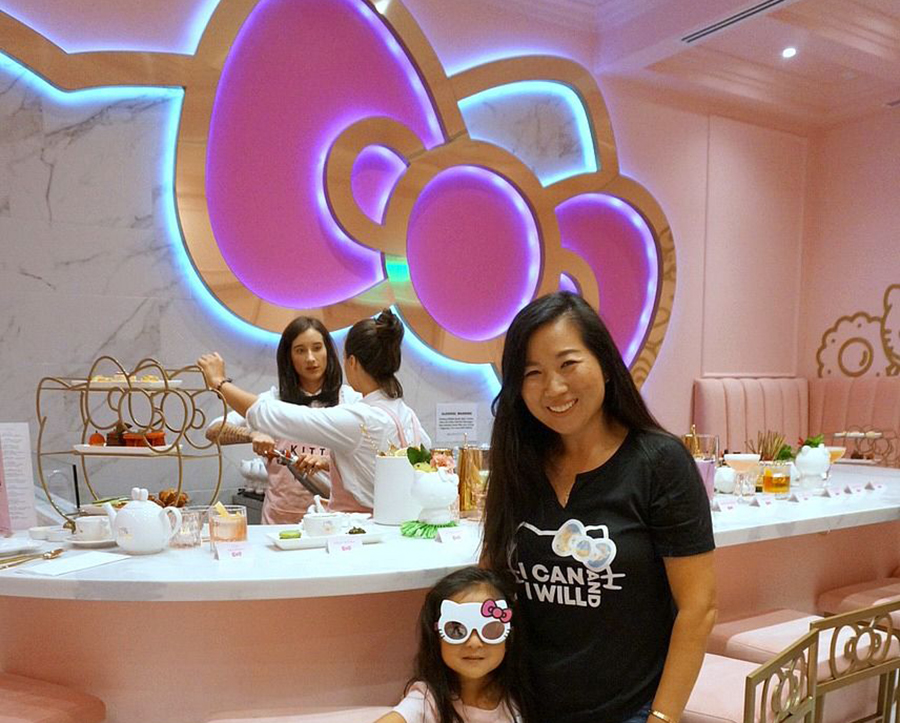 Mom and daughter take a picture at the Hello Kitty Grand Cafe opening in Irvine, California