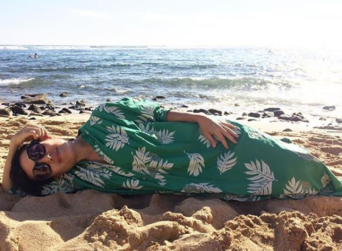 Shannon lies down on a beach in Kaui copy