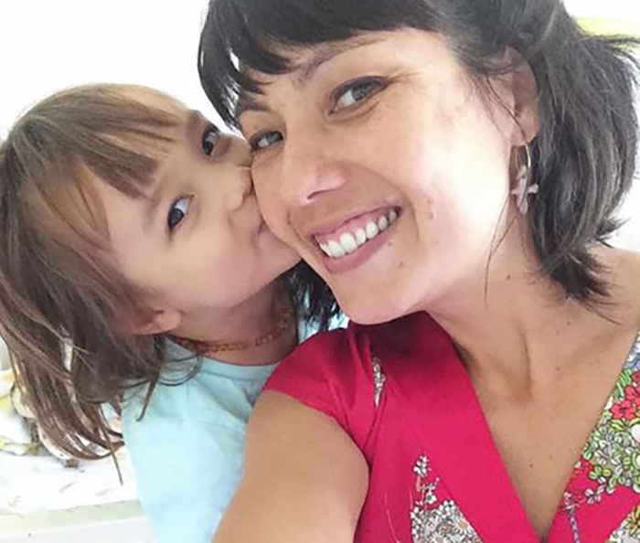 Shannon Hiramoto takes a photo with her three-year-old daughter