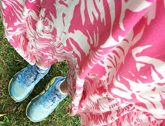 Picture of lower half of a pink and white muumuu