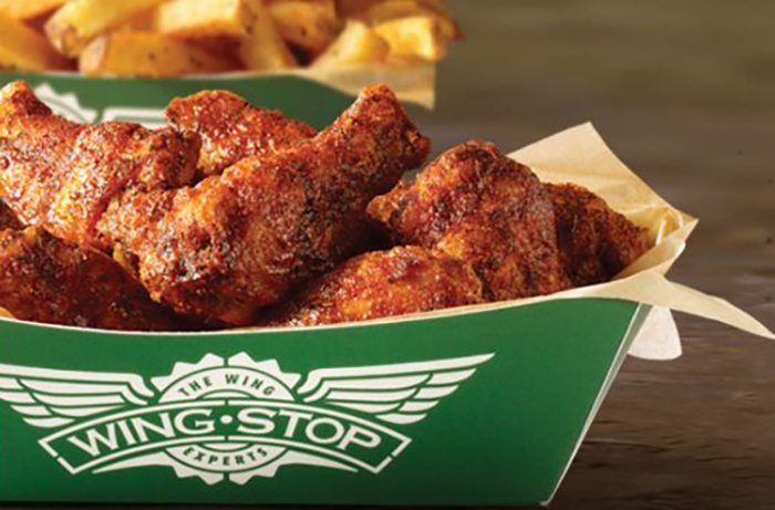 drumsticks in a Wingstop box