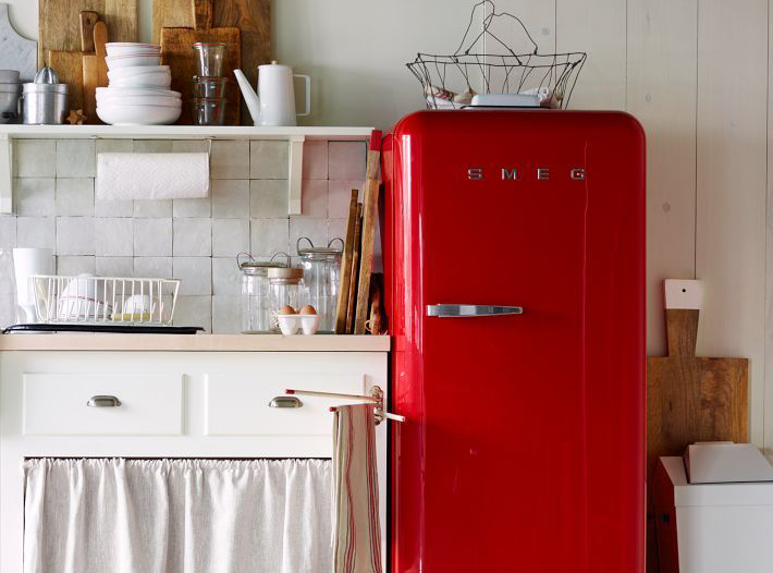 a bright red refrigerator in a white kitchen cropped copy