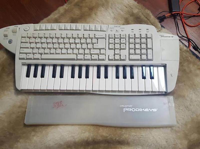 a piano keyboard built into a computer keyboard