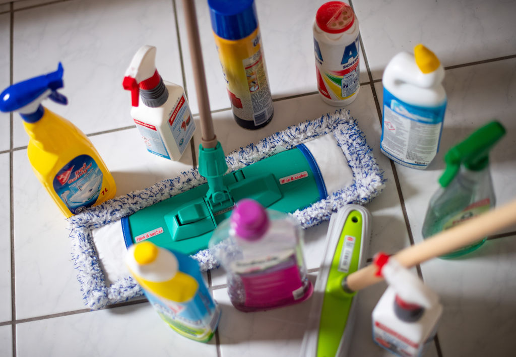cleaning products arranged on a tile floor