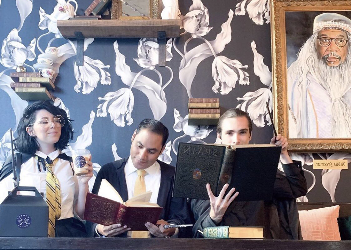 cosplayers at Nimbus Cafe, the Harry Potter themed house