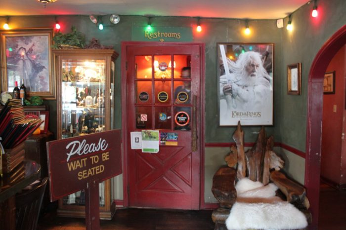 front door and decorations of the Hobbit Cafe in Upper Kirby, Texas
