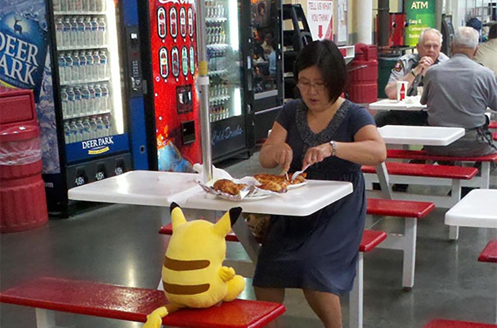 Woman eating food with stuffed animal