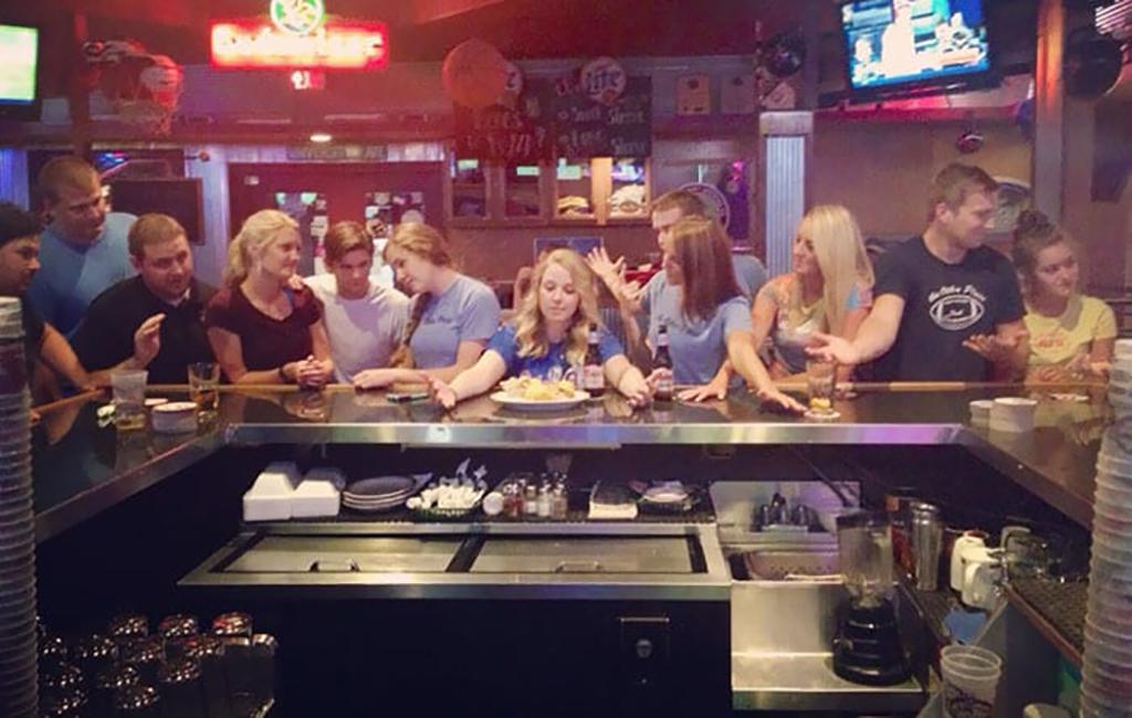 Waiters posing