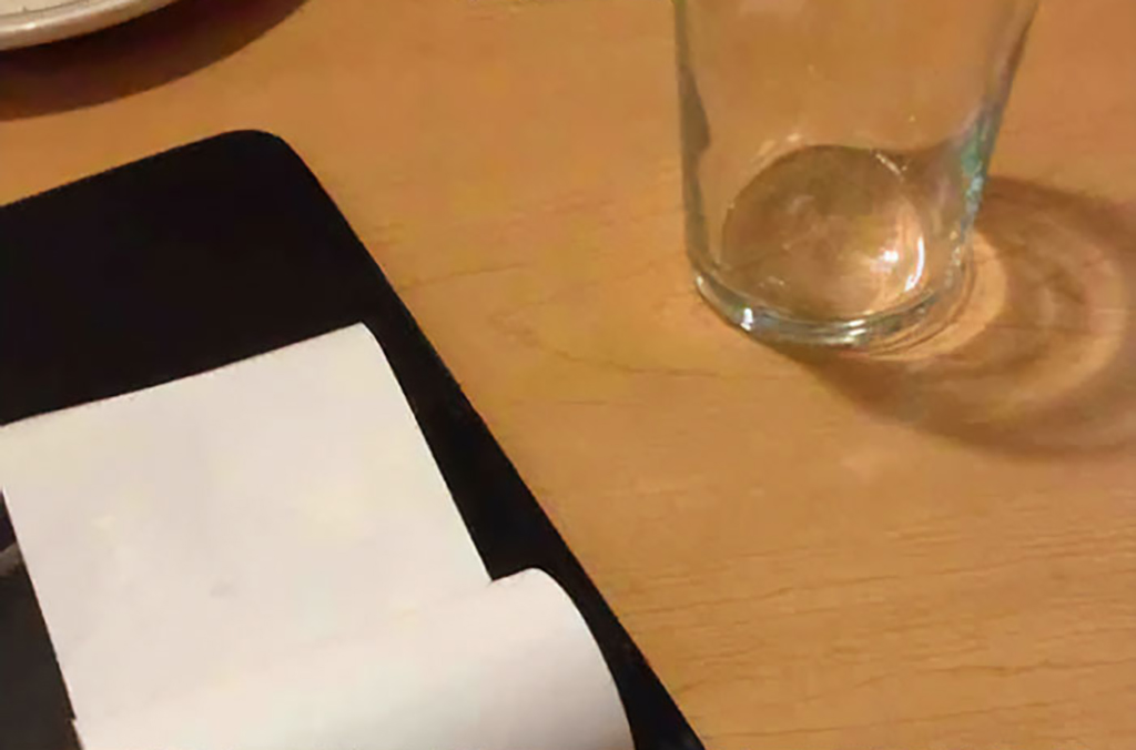 Empty glass and blank paper