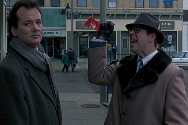 Phil and Ned talk on the street in Groundhog Day