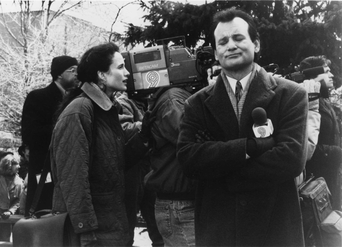 Phil and Rita working on the news in Groundhog Day