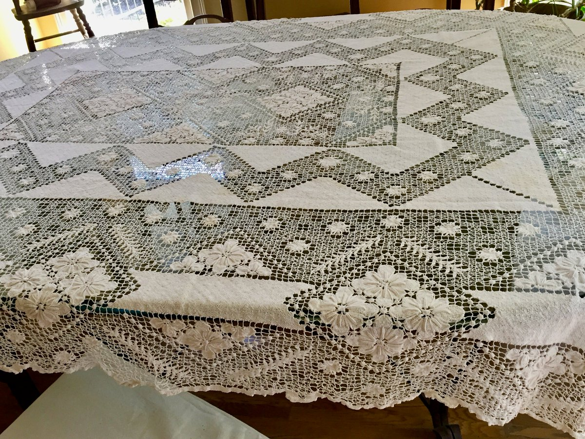 ivory lace tablecloth on a black table
