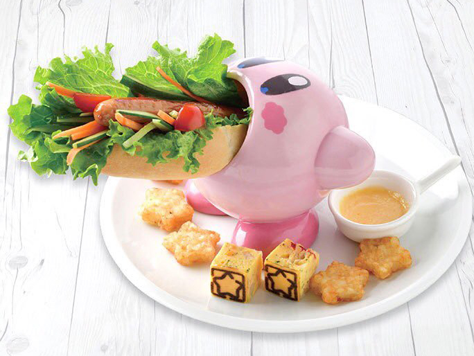 kirby ceramic swallowing a sandwich at the Kirby Cafe