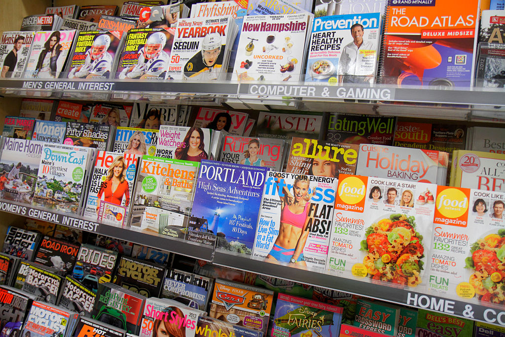 magazines on display at a grocery store