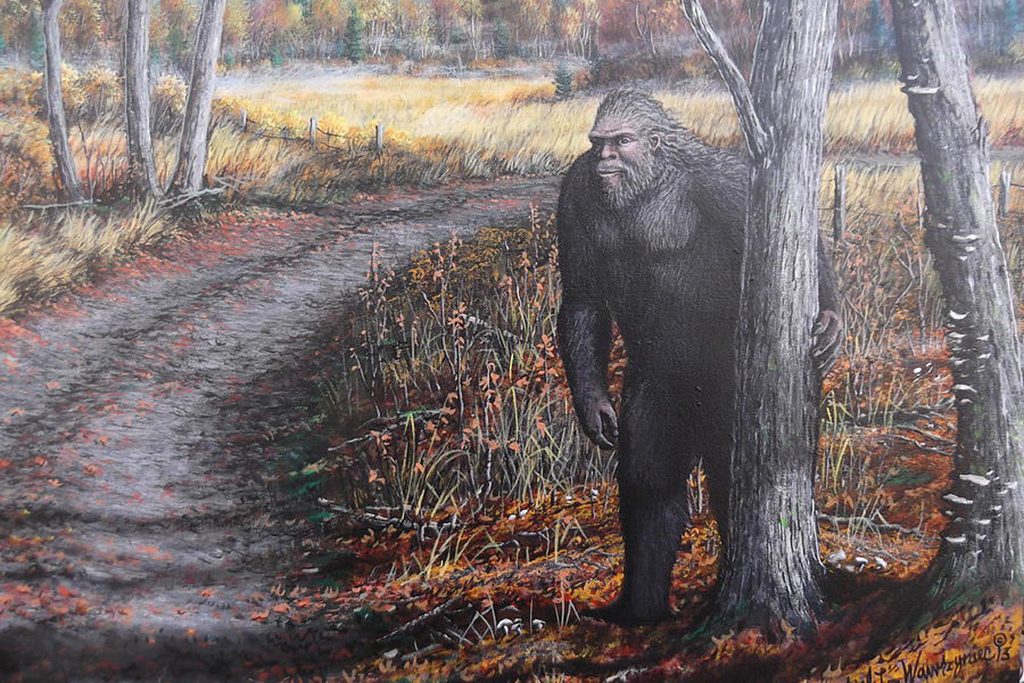 Bigfoot next to a tree