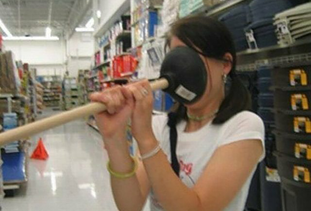 Woman puts plunger on face
