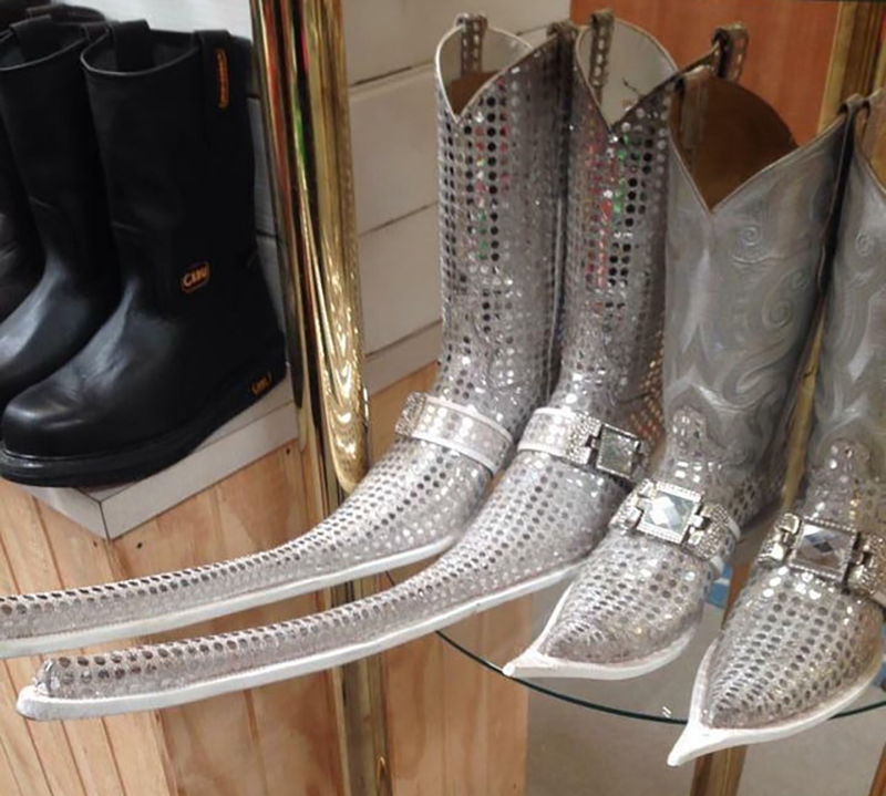 silver boots with egregiously long toes