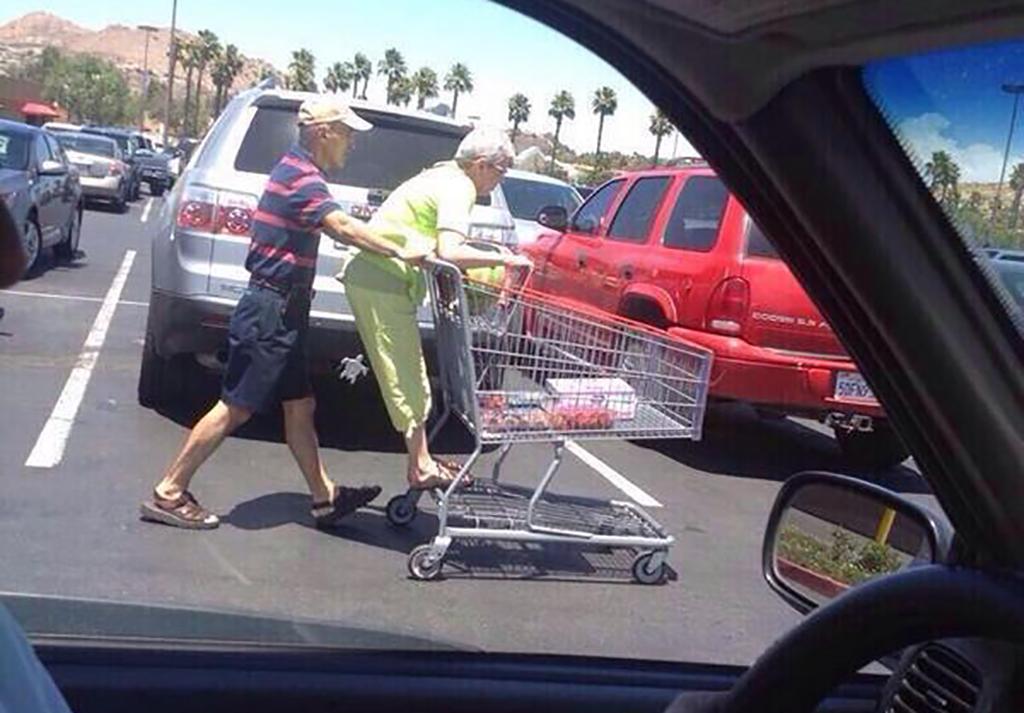 Pushing wife in shopping cart