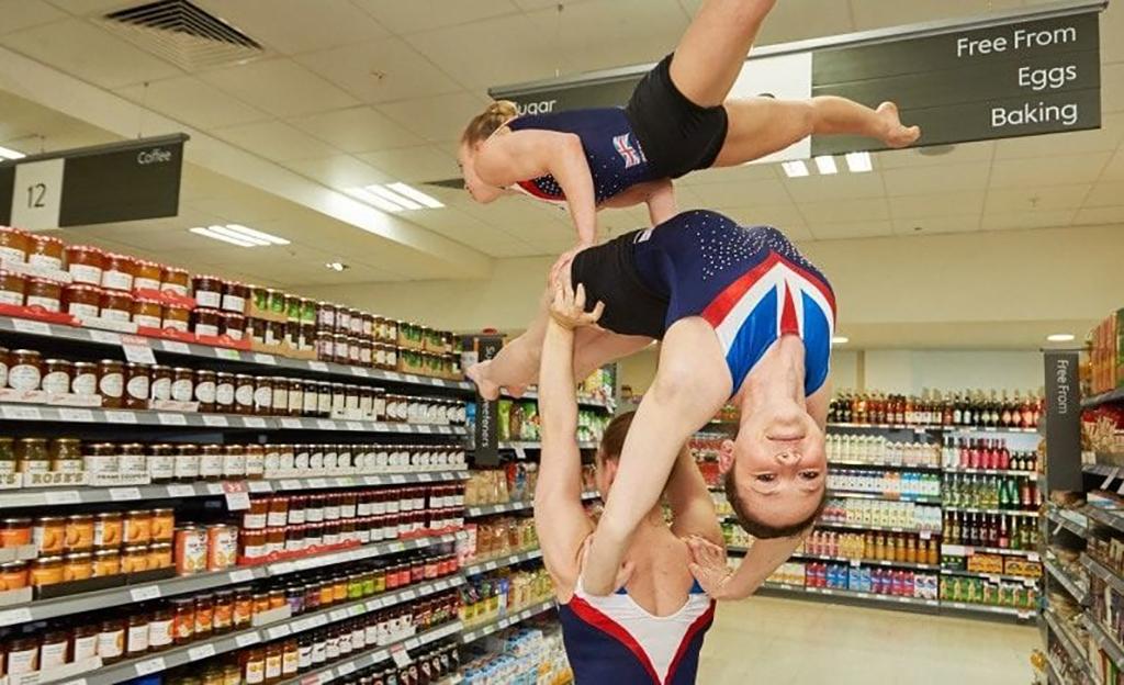 Girls do gymnastics in store