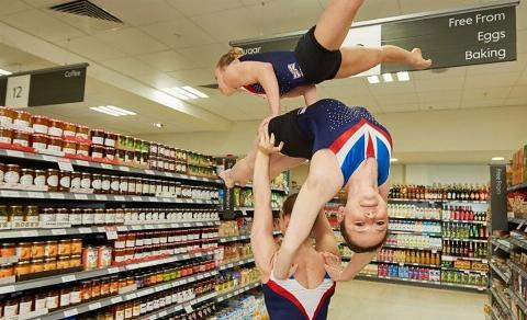 Girls do gymnastics in store