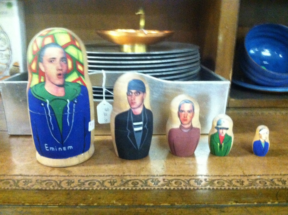 Slim Shady Russian nesting dolls on a thrift store shelf