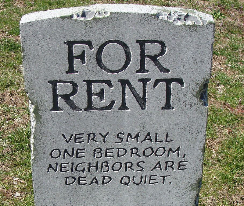 "A headstone reads ""For Rent Very Small One Bedroom Neighbors Are Dead Quiet"""