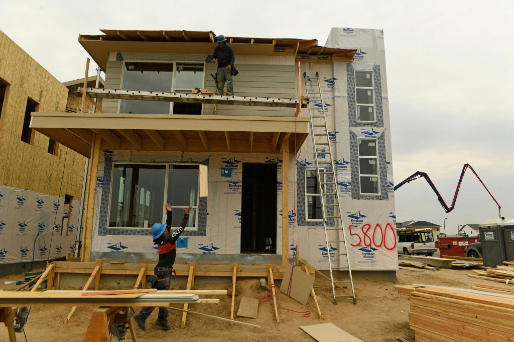 A home under construction is photographed from the backyard
