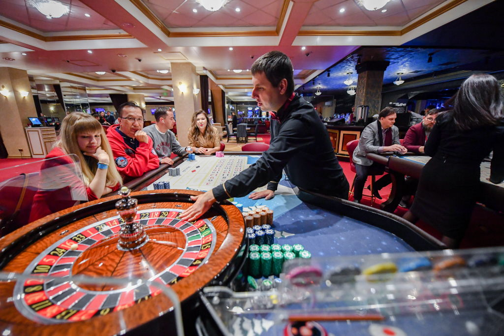 A dealer spin a wheel during a game in a casino
