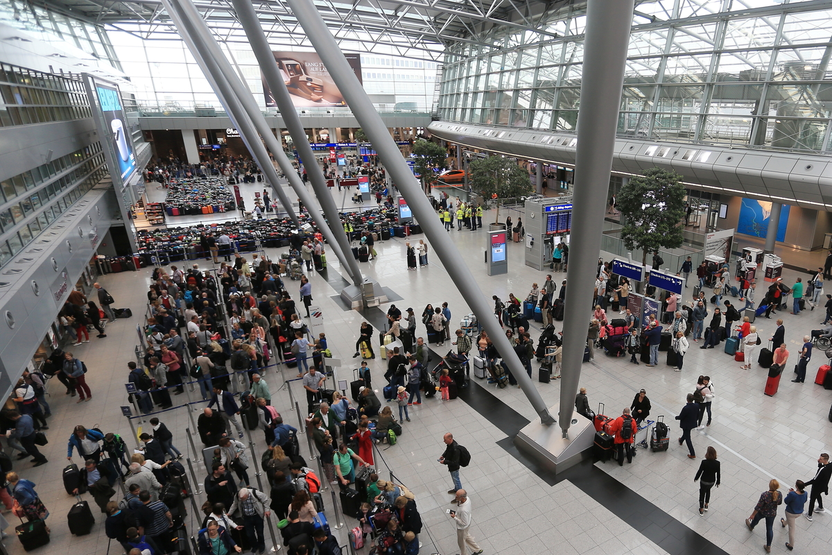 Long queues have formed at check-in counters in the departure terminal of the airport