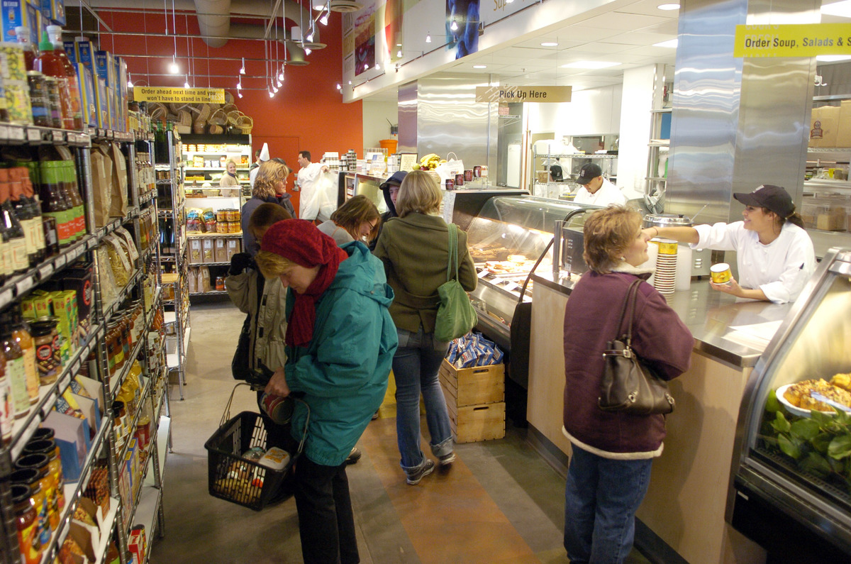Shoppers pack the aisles and deli counter at Cook's Fresh Market