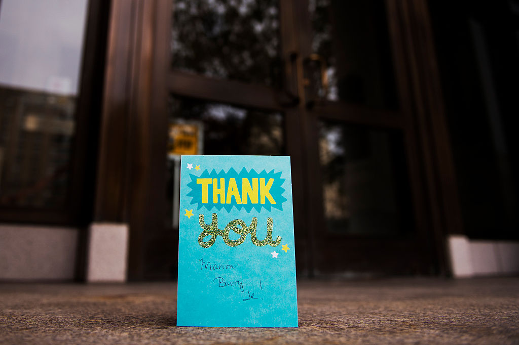 A thank you card is left on a doorstep